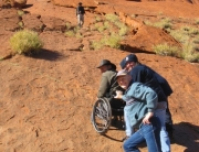 John climbing Ayers Rock in Oz